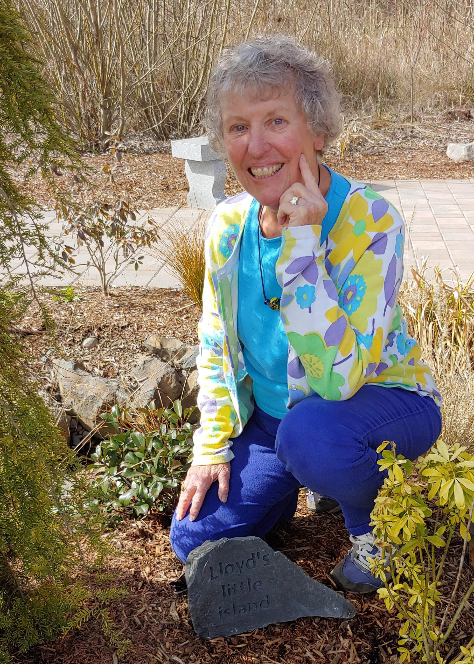 Betty DeWerf with her husband's memorial rock